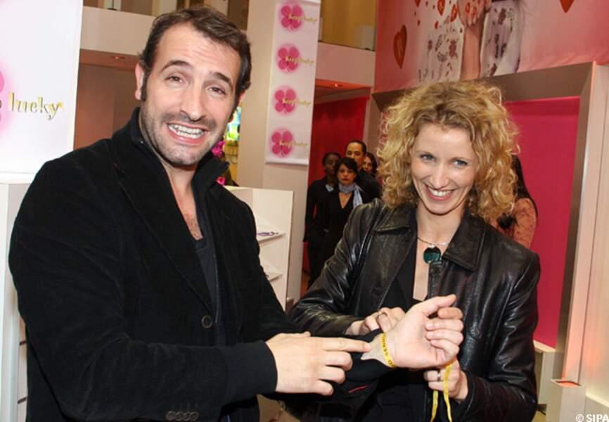 Jean Dujardin et Alexandra Lamy lancent les porte bonheur Keep Lucky en 2005