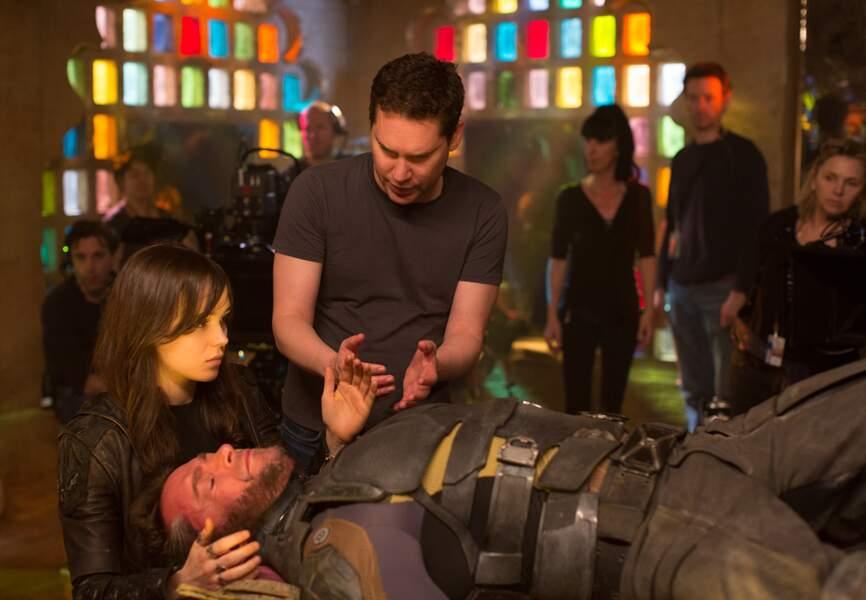 Bryan Singer en train de conseiller Ellen Page et Hugh Jackman