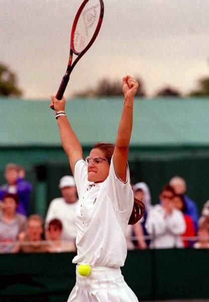 L'année suivante, en 1996,  elle est sacrée championne du monde juniors