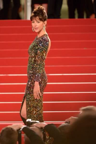 Sophie Marceau en robe Saint Laurent par Hedi Slimane et bijoux Chopard