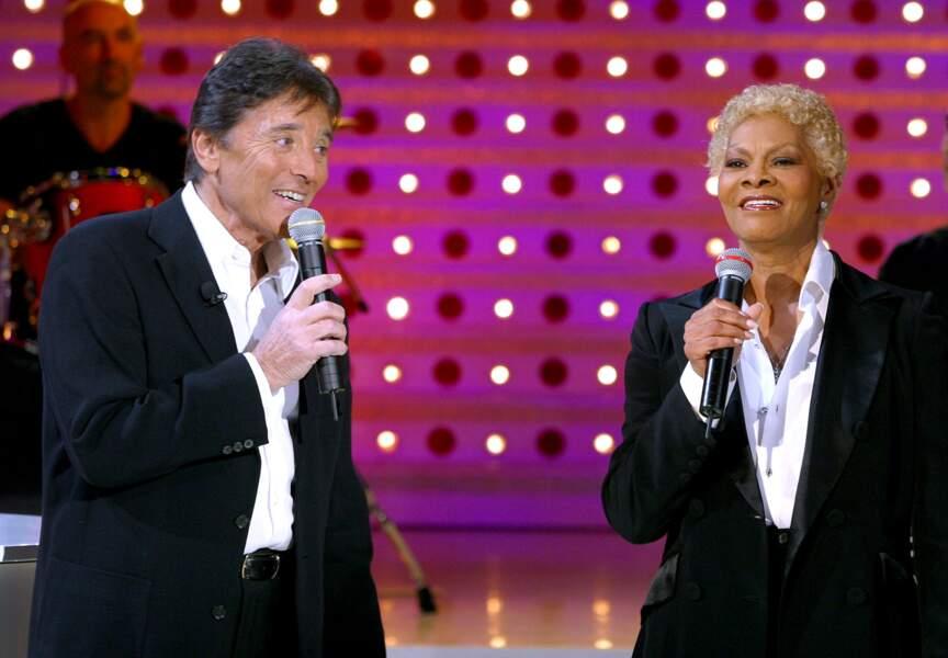 """En 2003, il retrouve la chanteuse américaine Dionne Warwick dans """"Vivement Dimanche"""" présenté par Michel Drucker"""
