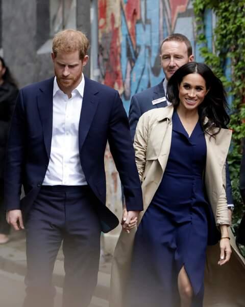 Les futurs parents, le prince Harry et Meghan Markle, main dans la main à Melbourne pour un moment de partage.