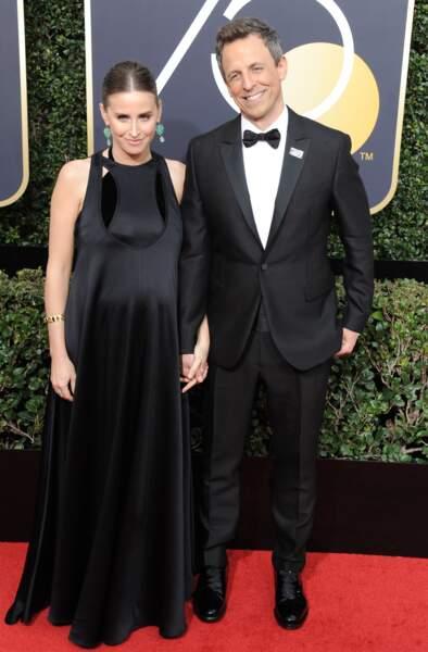 Seth Meyers et sa femme Alexi Ashe qui affiche sa grossesse dans une robe longue noire et en satin ultra chic