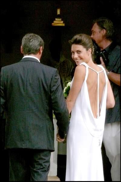 Alessandra Sublet au bras de son père le jour de son mariage religieux avec Thomas Volpi