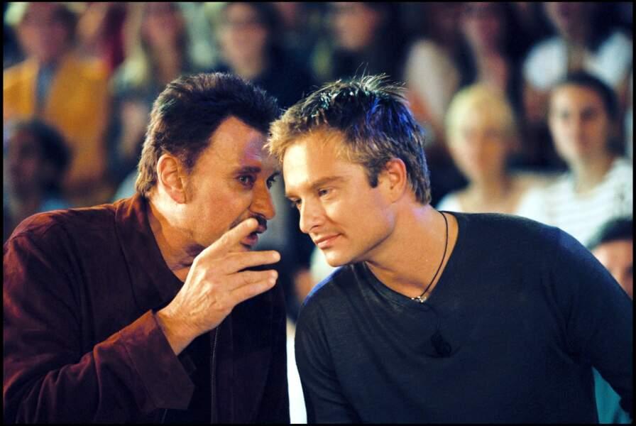 """Johnny et David Hallyday sur le plateau de l'émission """"Nulle Part Ailleurs"""" en 1999"""