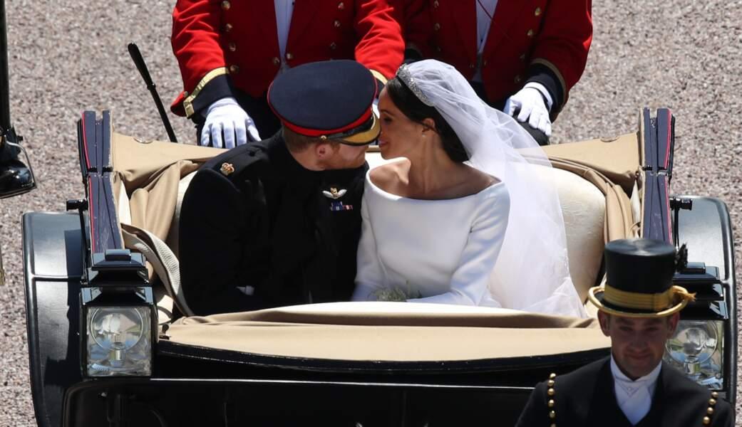 Le prince Harry et Meghan Markle en calèche à la sortie du château de Windsor, après leur mariage, le 19 mai 2018.