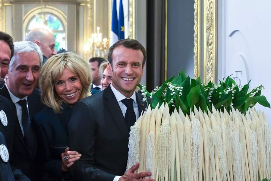 Brigitte et Emmanuel Macron sont apparus tout sourire pour la fêter du 1er mai qui avait lieu à l'Élysée
