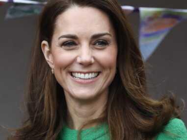 PHOTOS - Kate Middleton fait sensation dans une robe verte flashy et une paire de boots montantes