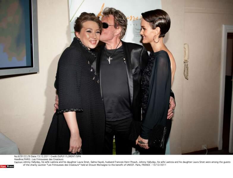Laura Smet, Johnny et Laeticia Hallyday lors d'une vente aux enchères au profit de l'UNICEF, à Paris en 2011