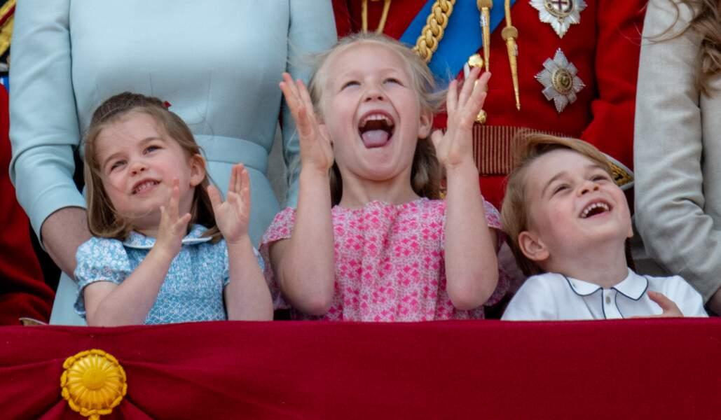 """Charlotte, Savannah Phillips et George au balcon de Buckingham, lors de la parade """"Trooping the colour"""" en 2018"""