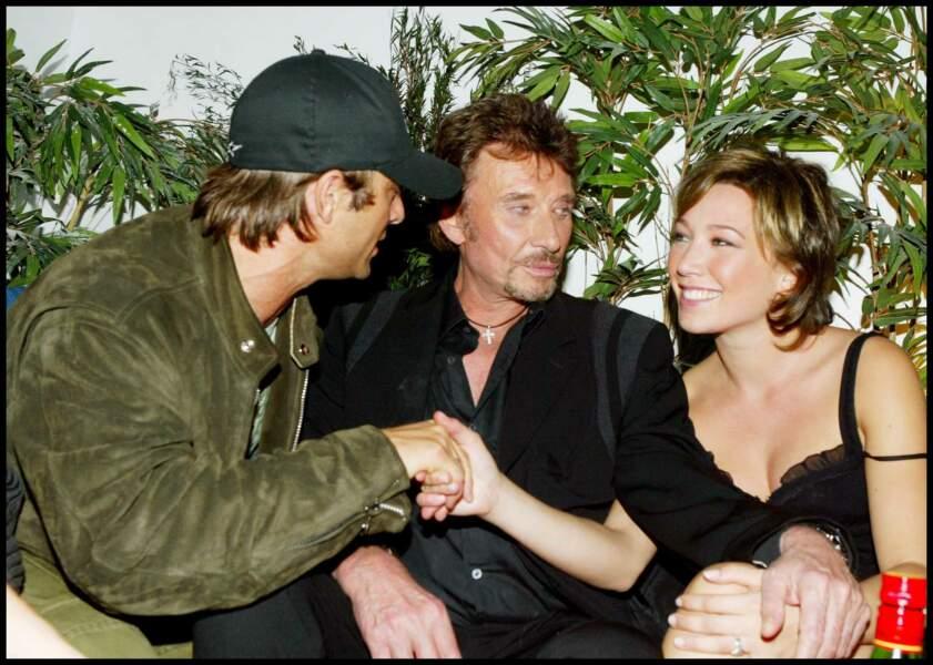 Laura Smet, avec David et Johnny Hallyday à l'inauguration de l'Amnesia à Paris, en 2003