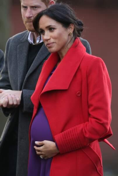 Avec cette visite, la duchesse de Sussex démontre qu'elle oeuvrera le plus loin possible dans sa grossesse