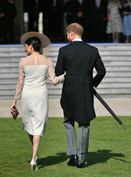 Le prince Harry, duc de Sussex, et Meghan Markle, duchesse de Sussex, lors de la garden party à Buckingham Palace
