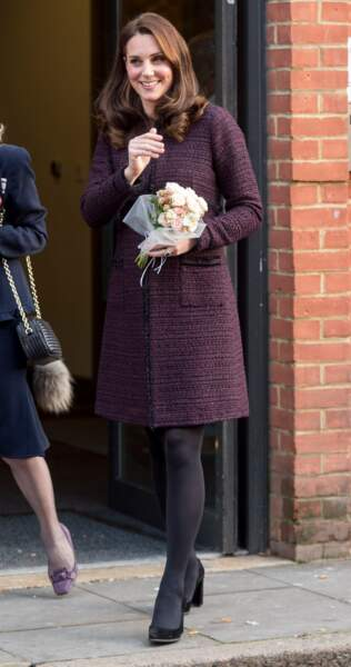 Kate Middleton dans son manteau prune, à l'occasion d'une fête de Noel caritative à Londres, le 12 décembre 2017