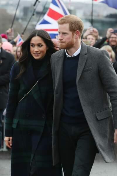 Meghan Markle au bras du Prince Harry lors d'une visite officielle du couple à Édimbourg en Écosse le 13/02/2018