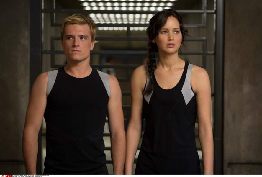 """Josh Hutcherson et Jennifer Lawrence dans une scène du film """"Hunger Games : l'Embrasement"""" (2013)"""