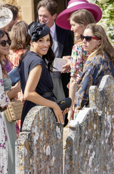 La duchesse porte une robe Club Monaco et un chapeau Philip Treacy.