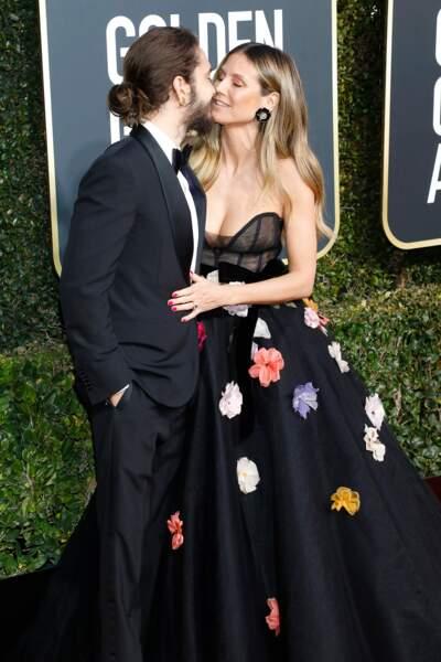 Heidi Klum (en robe Monique Lhuillier) et son fiancé Tom Kaulitz lors des Golden Globes, le 6 janvier 2019