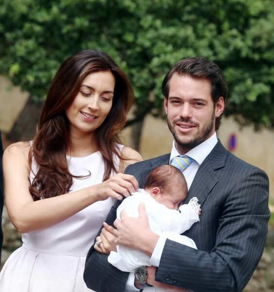 Félix du Luxembourg, son épouse Claire et leur fille la princesse Amalia lors son baptême le 12 juillet 2014
