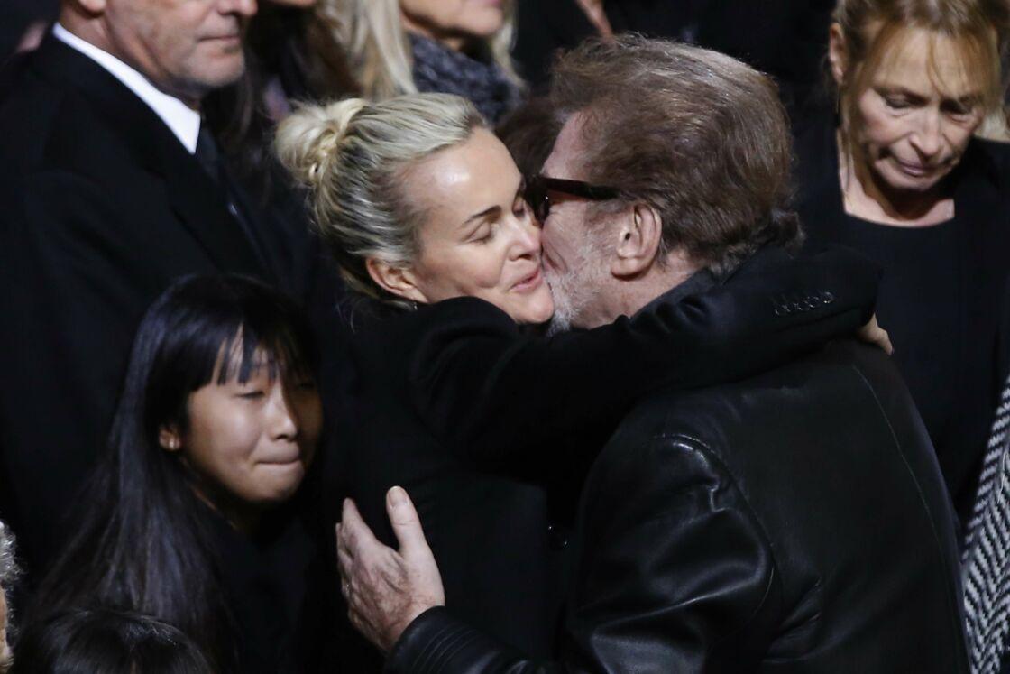 Laeticia Hallyday et Eddy Mitchell lors des obsèques du rockeur