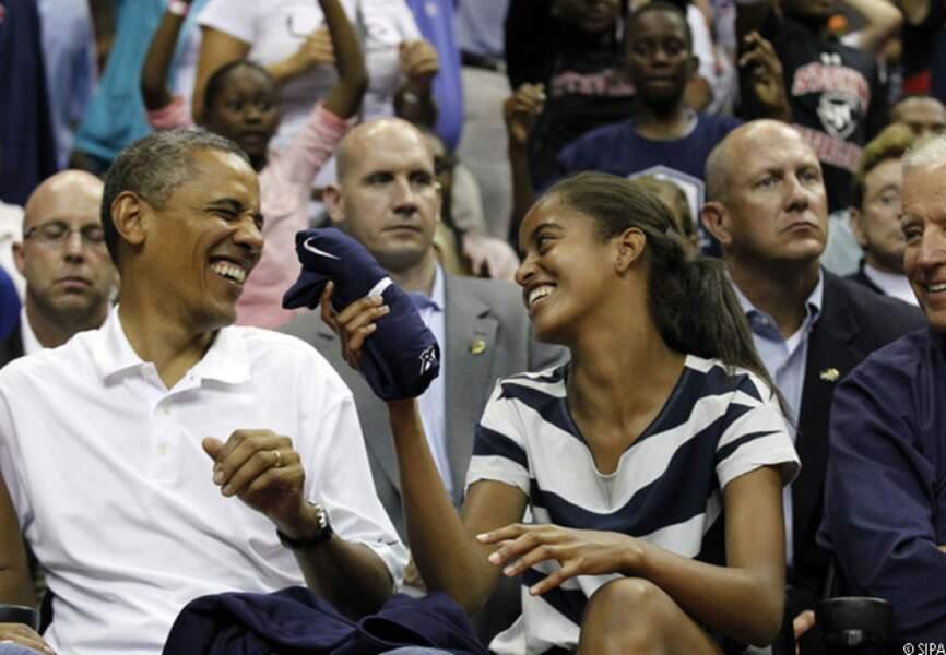 Baracj et Malia, complices pendant le match amical de basketball Etats-Unis-Brésil aux JO, 16 juillet 2012