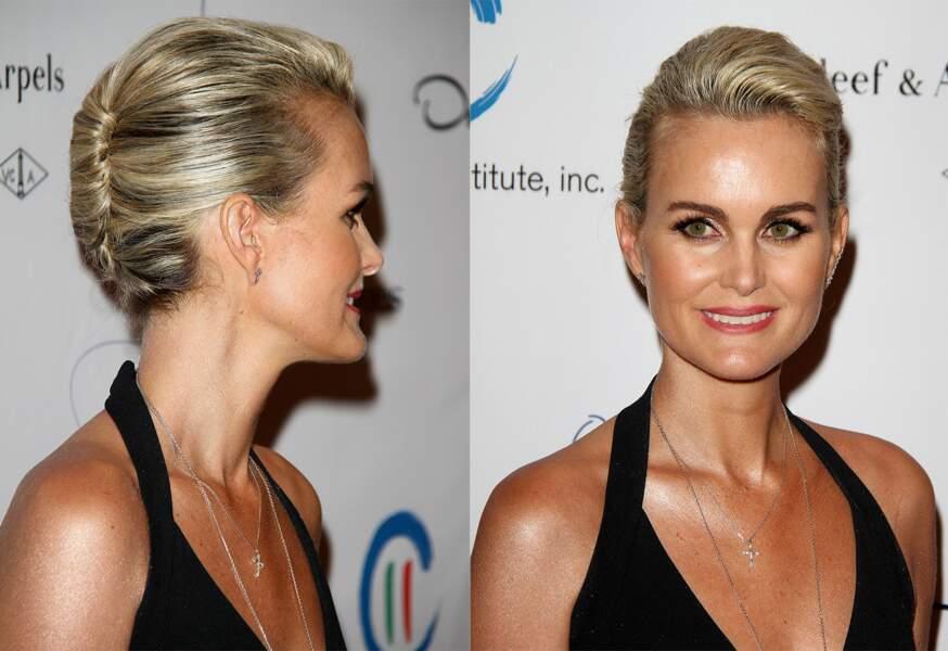 En 2014 coiffée d'un élégant chignon roulé sur le côté, lors d'une remise de prix à Los Angeles,