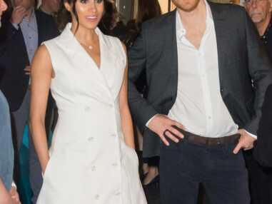 PHOTOS - Meghan Markle enceinte et sexy avec une robe blazer blanche qui dévoile ses jambes