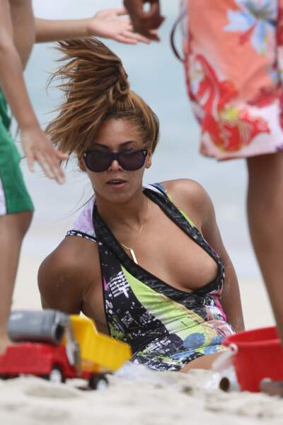 EXCLUSIVE: Beyonce gets her bootylicious body buried in sand while vacationing with husband Jay-Z in Hawaii.