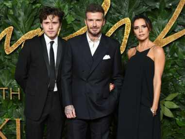 PHOTOS - Les Beckham très élégants aux côtés de leur fils Brooklyn
