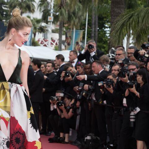 PHOTOS – Amber Heard très décolletée, ses tatouages électrisent le tapis rouge de Cannes 2018