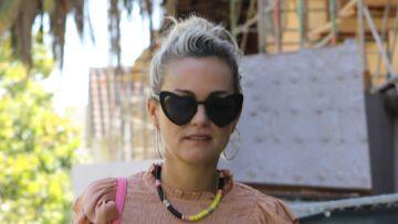 PHOTOS – Laeticia Hallyday agacée d'être traquée par les photographes, comme elle tente de se cacher