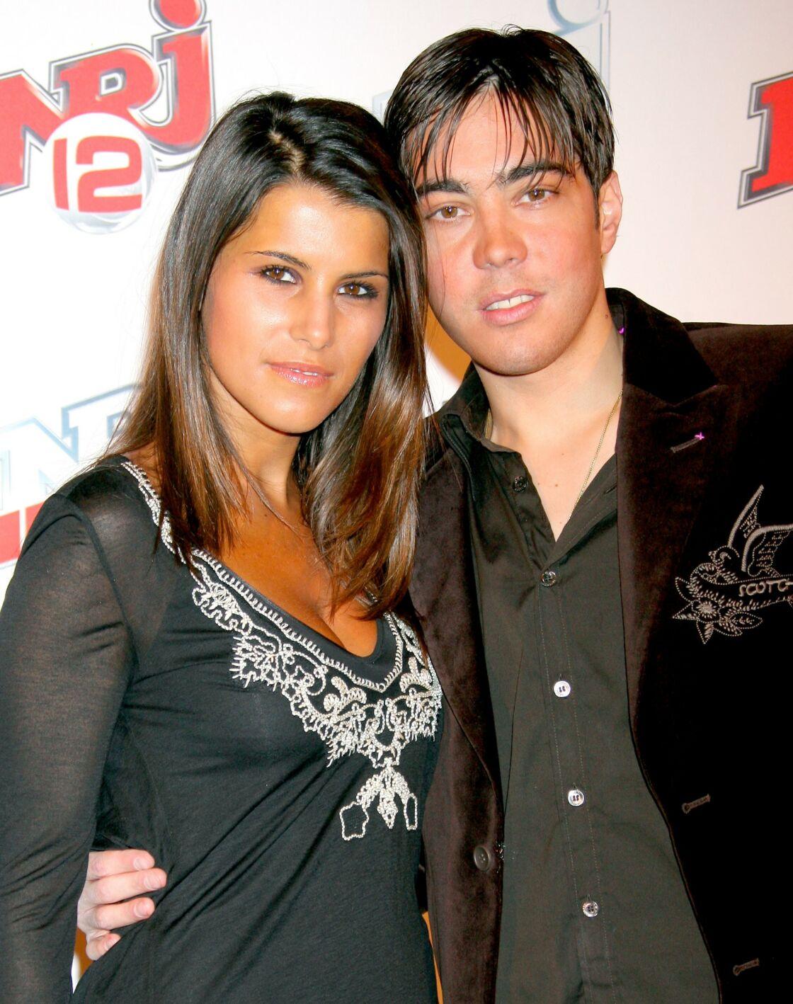 Grégory Lemarchal et sa compagne Karine Ferri à la soirée des deux ans de la chaîne NRJ 12, à Paris, le 23 mars 2007.