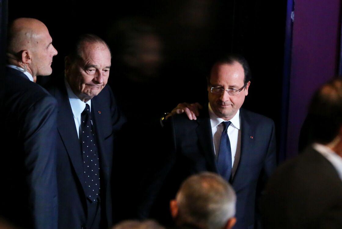 Jacques Chirac et François Hollande au musée du quai Branly, à Paris, le 21 novembre 2013.