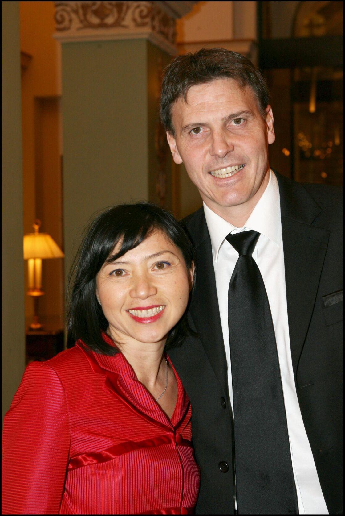 Anh Dao Traxel et son second mari, à Paris, le 11 décembre 2006.