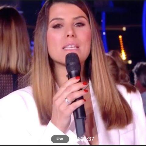 PHOTOS – Karine Ferri très sexy en robe blanche, courte et décolleté pigeonnant