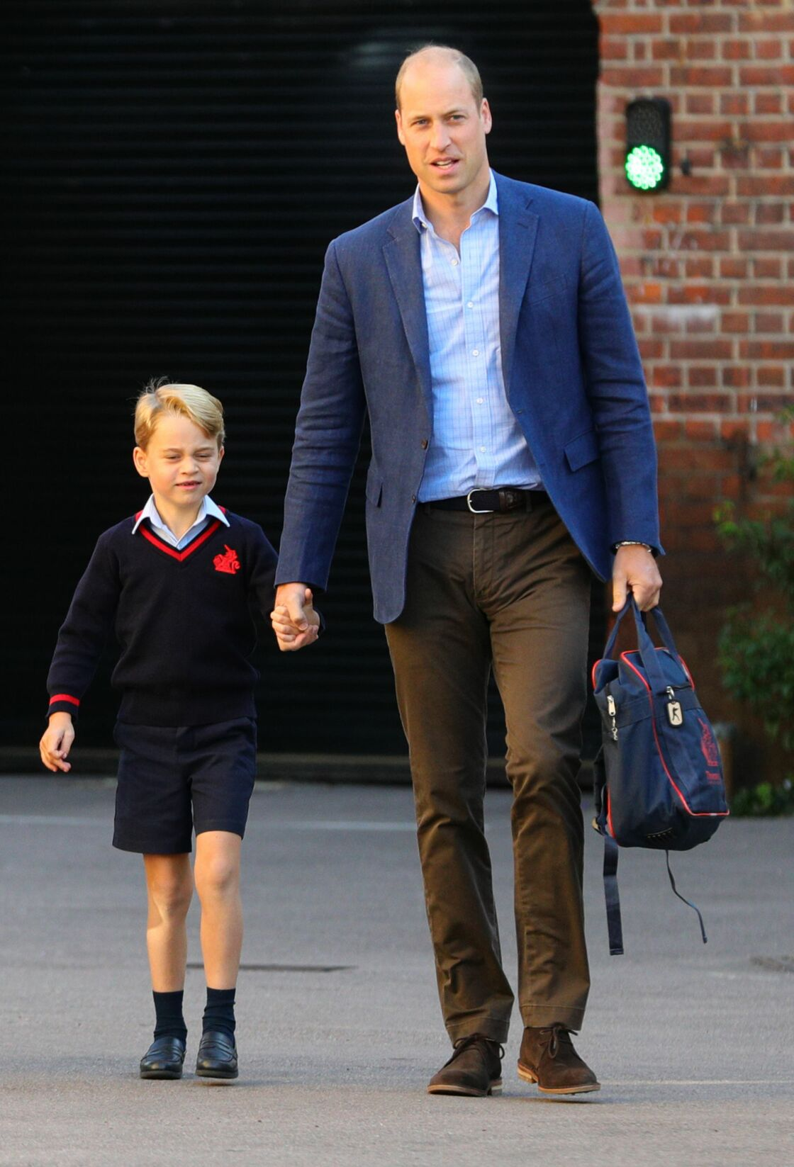 Le prince George et son papa, le prince William, à la rentrée des classes de Thomas's Battersea à Londres, le 5 septembre 2019.