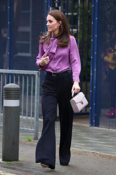 """Kate Middleton lors d'une visite au centre pour enfants """"Henry Fawcett"""" à Londres, le 12 mars 2019"""