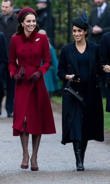 Meghan Markle très chic en manteau long et bottes noires en décembre 2018.