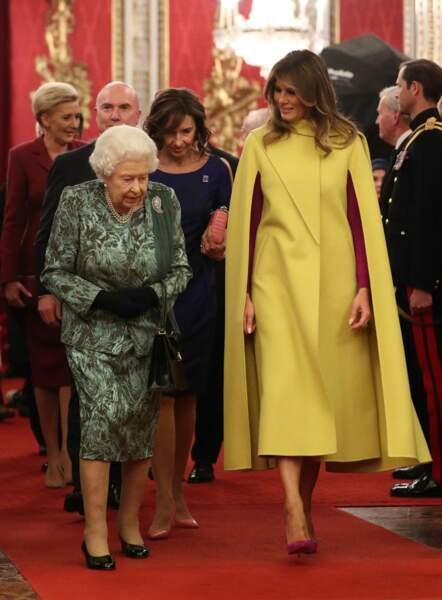 Melania Trump rayonnante dans un manteau cape jaune poussin Valentino à 4.000 euros à la réception organisée à Clarence House en marge des 70 ans de l'OTAN, à Londres, le 3 décembre 2019.