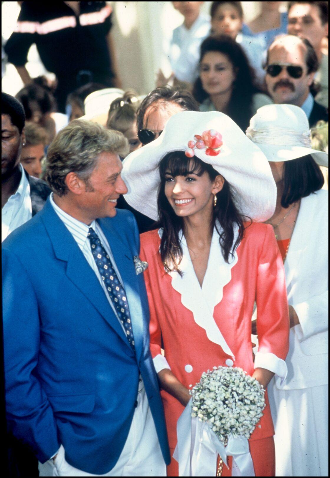 Adeline Blondieau et Johnny Hallyday, en 1990.