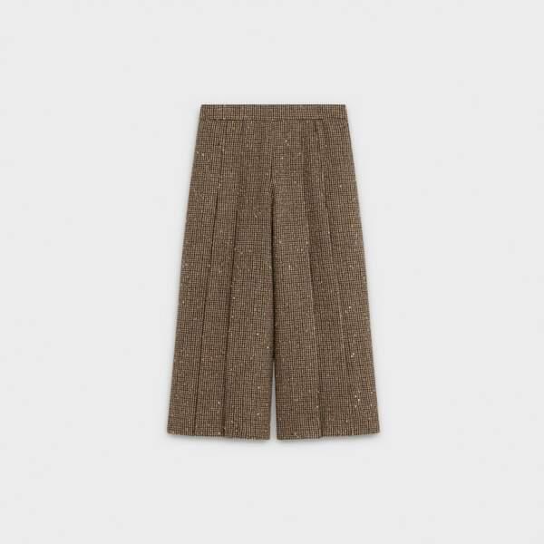 La jupe culotte plissée en tweed à paillettes dorées, Celine, 2.390€.