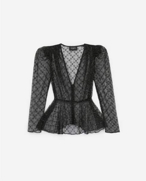 Le chemisier en dentelle noire transparente à paillettes, The Kooples, 198€.
