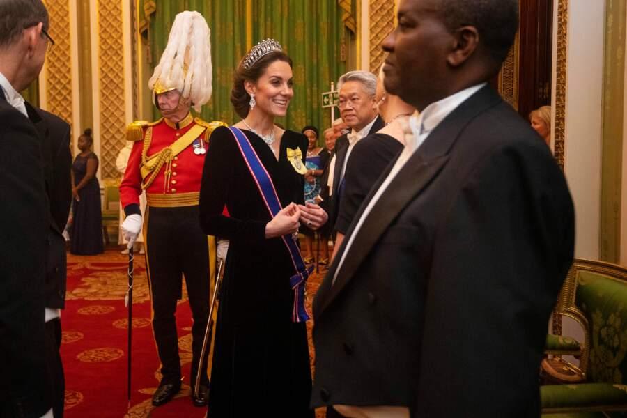 Kate Middleton, duchesse de Cambridge reçoit les membres du corps diplomatique à Buckingham Palace, le 11 décembre 2019.