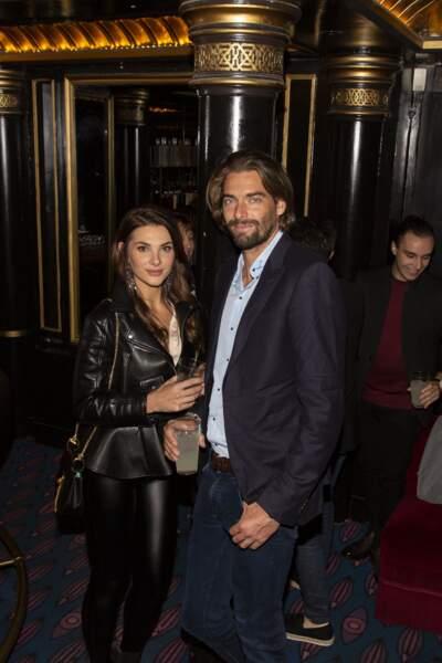 """En septembre dernier, Camille Lacourt et sa compagne Alice Detollenaere s'affichaient déjà ensemble durant la soirée de lancement de la vodka """"Touché"""", dont Anthony Colette était le directeur artistique."""
