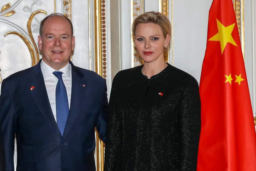 La princesse Charlene et le prince Albert II de Monaco pour un photocall tout en tendresse, lors de la réception du couple présidentiel chinois, le 24 mars 2019.