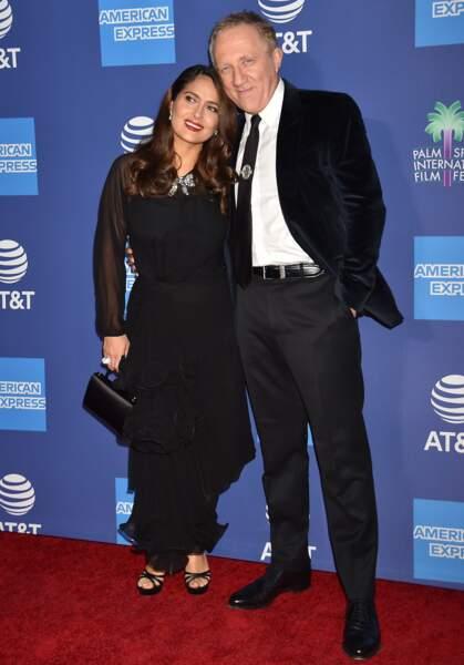 Salma Hayek en robe longue noire avec son mari François-Henri Pinault.