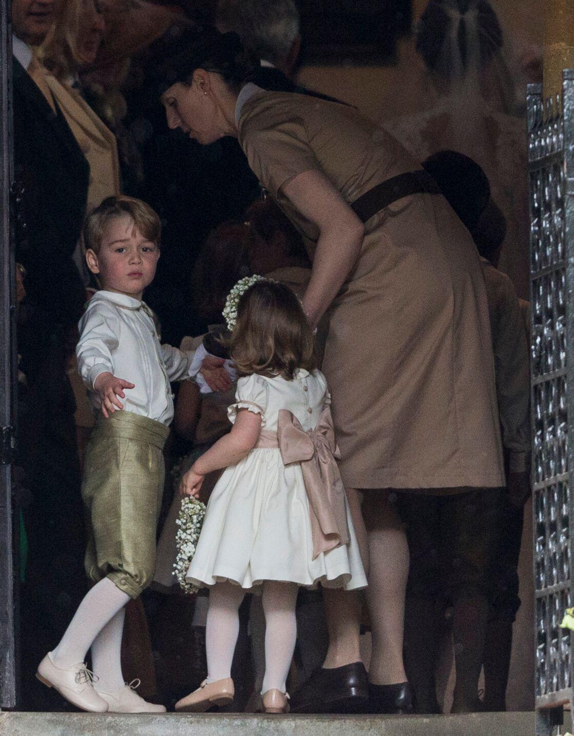 Le prince George de Cambridge, sa soeur la princesse Charlotte de Cambridge et la nounou Maria Borrallo - Mariage de P. Middleton et J. Matthew, en l'église St Mark Englefield, Berkshire, Royaume Uni, le 20 mai 2017.