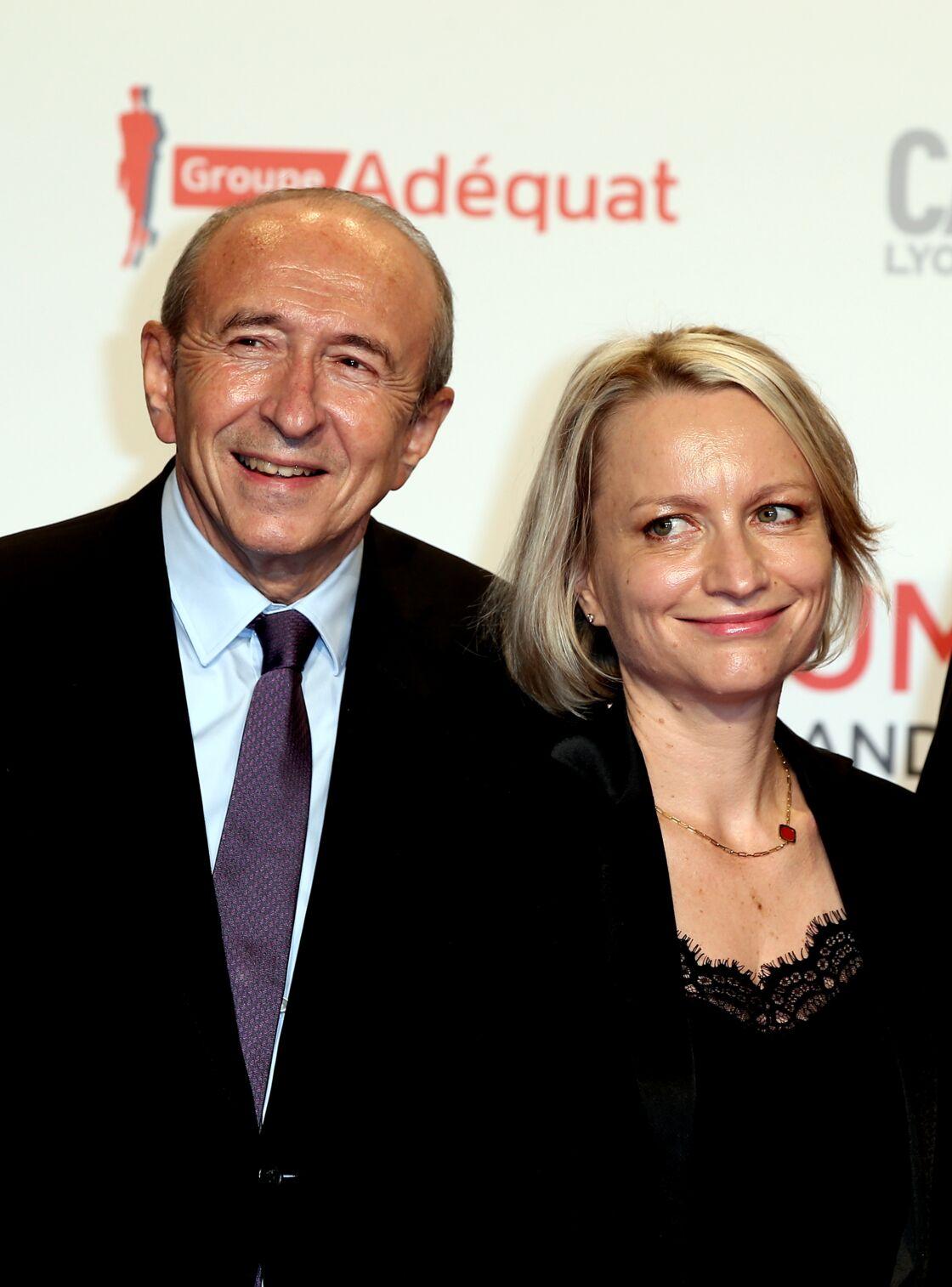 Gérard Collomb, avec sa femme Caroline, lors de l'ouverture du Festival Lumière, à Lyon, le 14 octobre 2017.