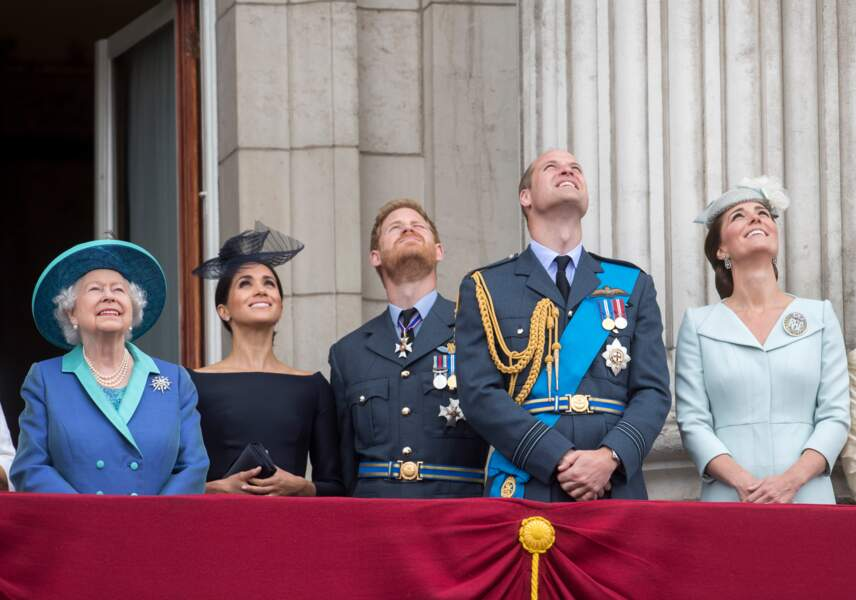Le prince William, le prince Harry, Kate Middleton et Meghan Markle lors de la parade aérienne de la RAF pour le centième anniversaire au palais de Buckingham à Londres. 10/07/18.