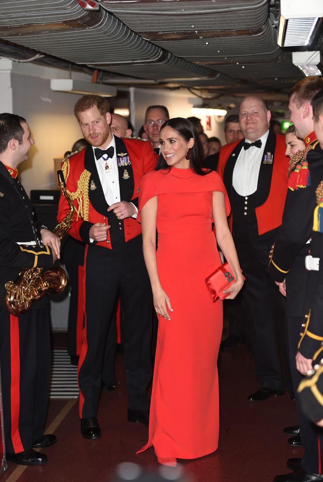 Harry et Meghan, après leur standing ovation au Royal Albert Hall de Londres, où ils assistaient au Mountbatten Festival of Music, le 7 mars 2020.